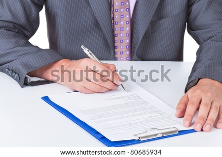 Businessman in elegant suits working with documents sign up contract isolated over white background - stock photo