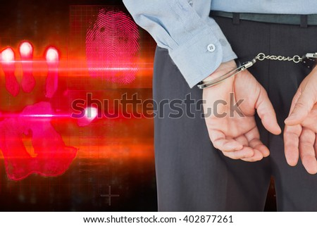 Businessman in formals with handcuffs against red technology hand print design - stock photo