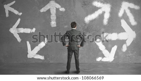 Businessman in front of a choice - stock photo