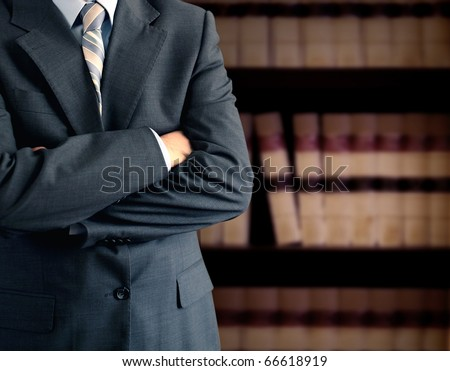 Businessman in front of bookcase - stock photo