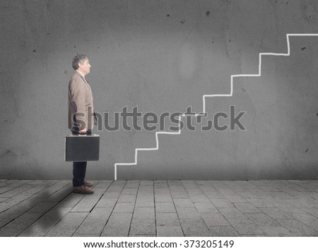 Businessman in front of drawing stairs