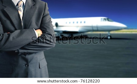 Businessman in front of private jet - stock photo