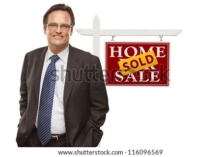Businessman in Front of Sold Home For Sale Real Estate Sign Isolated on a White Background.