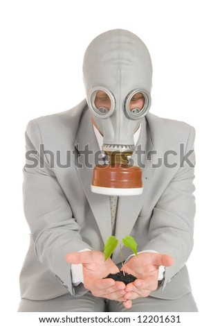 Businessman in gas mask holding green plant isolated - stock photo
