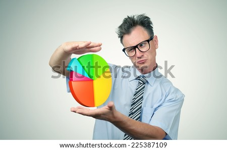 Businessman in glasses looking at the diagram