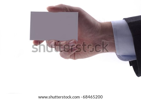Businessman in grey suit and a blue shirt shows professional business card with copy space, shallow dept of field