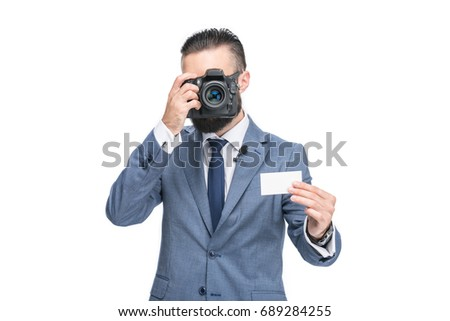 businessman in grey suit taking photo of empty card, isolated on white