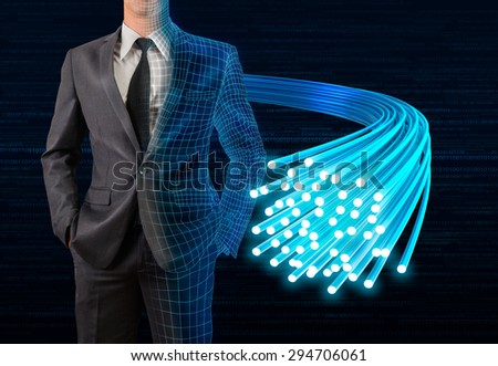 businessman in half wireframe surface standing with glow fiber optic cable  - stock photo
