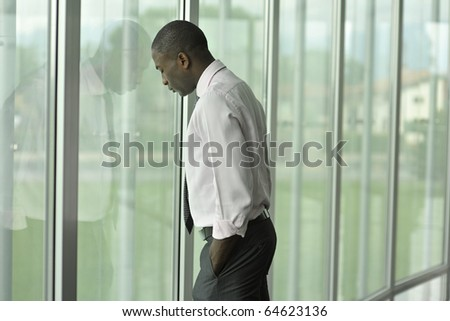 Businessman in his office, looking depressed