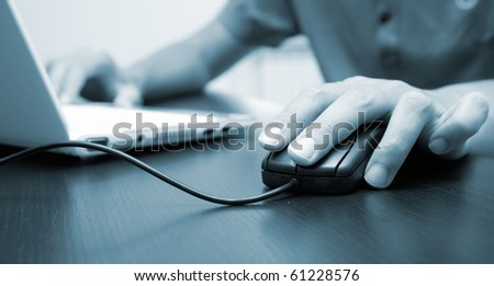 Businessman in his office, with blue tones - stock photo