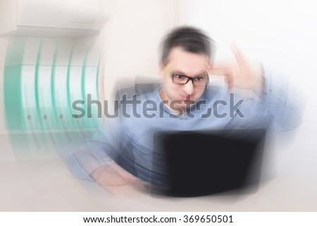 Businessman in his office with finger gun as concept for office burnout. Radial blur effect