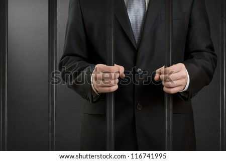 Businessman in jail - stock photo