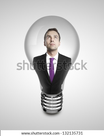 businessman in lamp on white background - stock photo