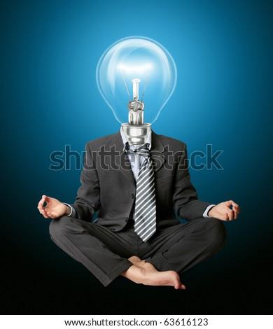 businessman in lotus pose and lamp-head meditating - stock photo