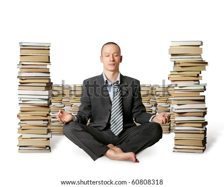 businessman in lotus pose with many books near isolated on white - stock photo
