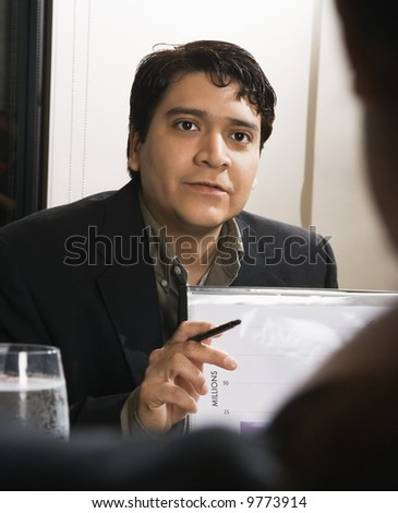Businessman in meeting with charts.