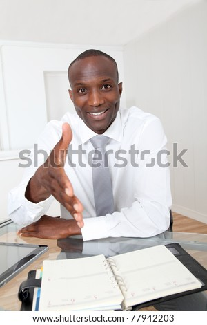 Businessman in office for an interview - stock photo