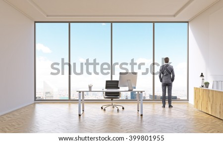 Businessman in office for one with table and closed shelf. Panoramic window. New York view. Concept of work. - stock photo