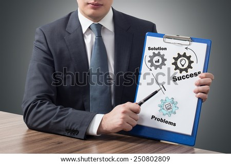 businessman in office holding clipboard with success concept - stock photo
