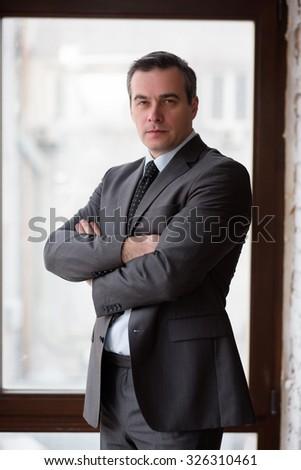 Businessman in office near window - stock photo