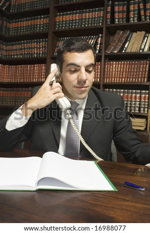 Businessman in office on phone. Vertically framed photo. - stock photo