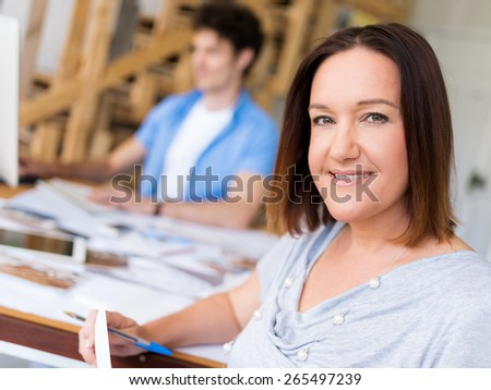 Businessman in office with her collegue at background - stock photo