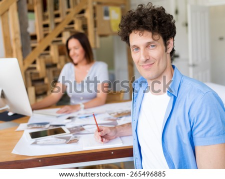 Businessman in office with his collegue at background - stock photo