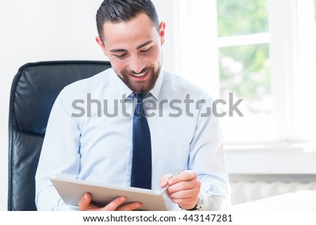 Businessman in office with tablet computer