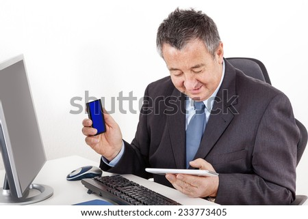 Businessman in office with tablet PC - stock photo