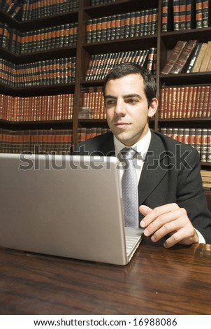 Businessman in office working on laptop computer. Vertically framed photo. - stock photo
