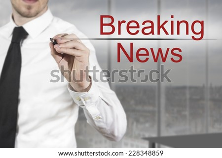 businessman in office writing breaking news in the air - stock photo