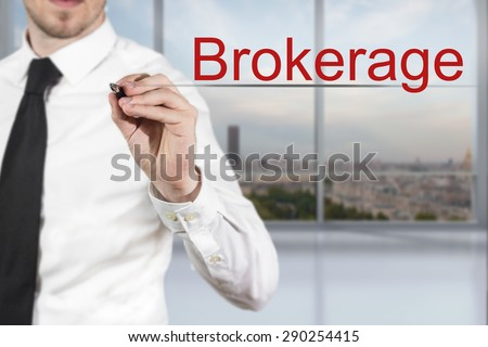 businessman in office writing brokerage in the air - stock photo