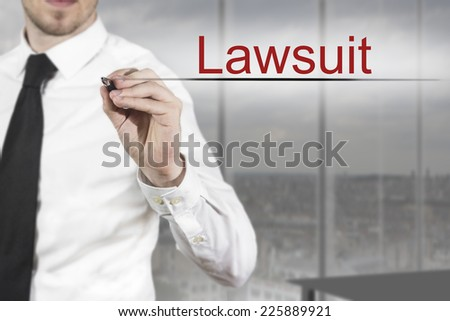 businessman in office writing lawsuit in the air - stock photo