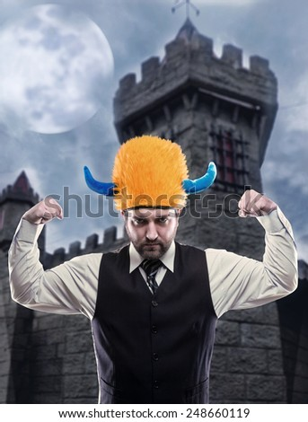 Businessman in party helmet  - stock photo