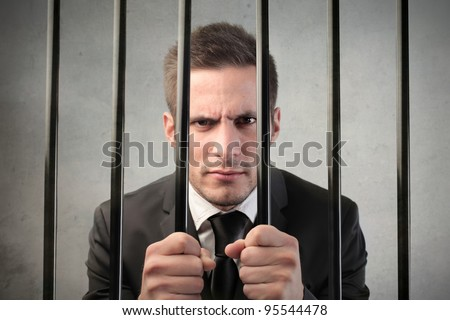 Businessman in prison - stock photo