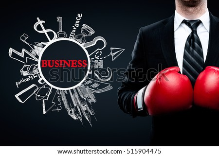 Businessman in red boxing gloves next to creative business sketch on black background. Leadership and competition concept