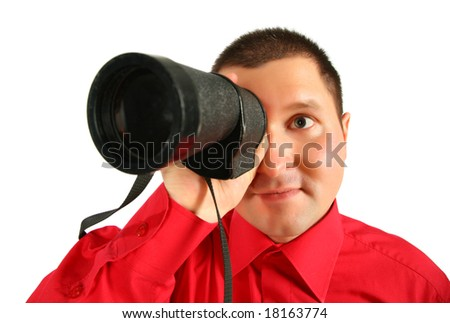 Businessman in red shirt looks in  spyglass - stock photo