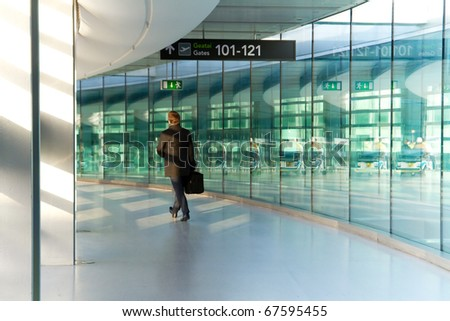 Businessman in rush at the airport - stock photo