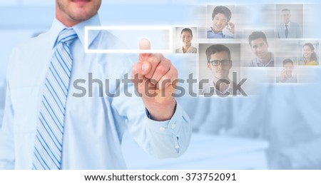 Businessman in shirt pointing with his finger against blue background - stock photo