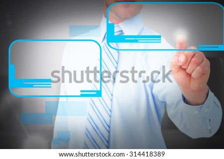Businessman in shirt pointing with his finger against white pillars
