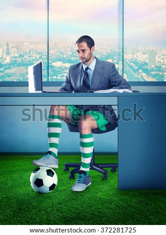 Businessman in shorts and with a ball under the table - stock photo