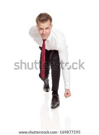 Businessman in starting position ready for chasing deals - stock photo