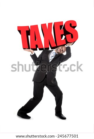 businessman in stress carrying heavy taxes 3d text word on his shoulders as a painful burden isolated on white background in tax paying and financial problem concept - stock photo