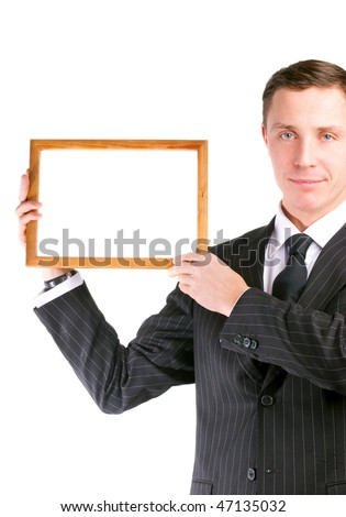 Businessman in stylish black suit holding empty frame - stock photo