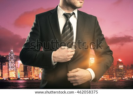 Businessman in suit and tie on red city background with abstract sunlight
