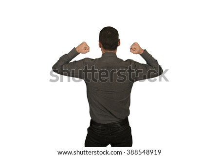 Businessman in suit backwards with a winner gesture - stock photo