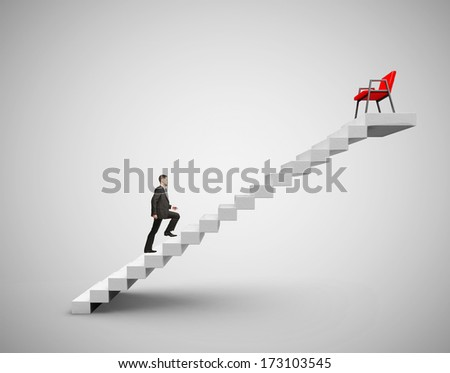 businessman in suit climbing to chair - stock photo