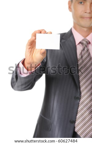 Businessman in suit handing a white blank. Isolated on white background - stock photo