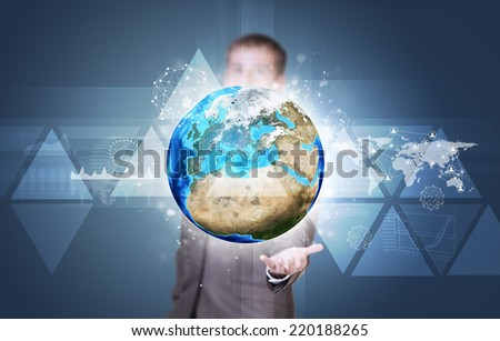 Businessman in suit hold Earth with graphs and network. Elements of this image are furnished by NASA