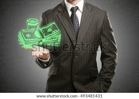 Businessman in suit holding creative dollar bill sketch on textured concrete background. Increasing profit concept